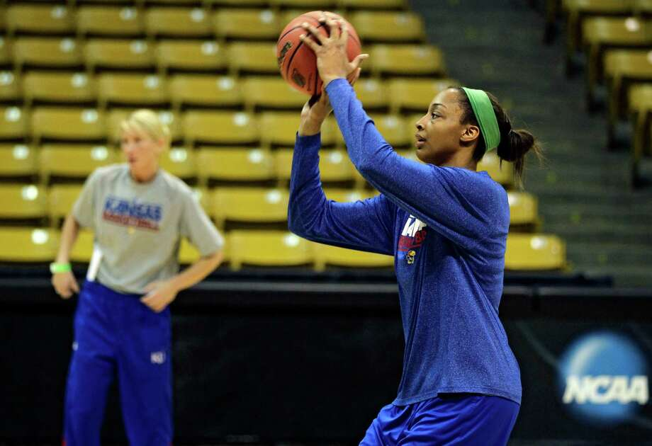 Kansas player Carolyn Davis warms up during practice for a first-round game in the women's NCAA college basketball tournament in Boulder, Colo., Friday, March 22, 2013. Kansas will play Colorado on Saturday. (AP Photo/Brennan Linsley) Photo: Brennan Linsley, Associated Press / AP