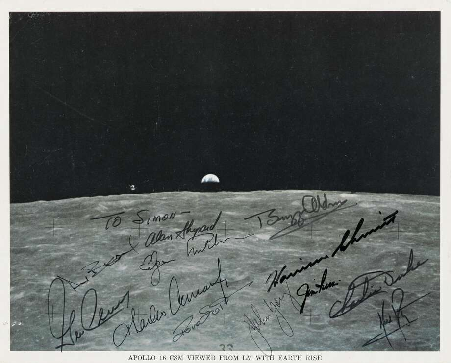 NASA color photograph, 10 by 8 inches, of the Apollo 16 Command Module orbiting the moon with an Earth rise in the background, signed by all 12 men who walked on the moon. Sold at auction for $35,000.(All Images: Bonhams)