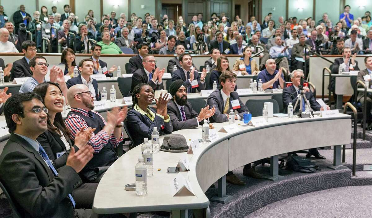 The Springboard Enterprises Dolphin Tank program is bringing its friendly pitch session to Houston. Pictured is audience members applauding during a Rice Business Plan Competition. (Craig H. Hartley/For the Chronicle)