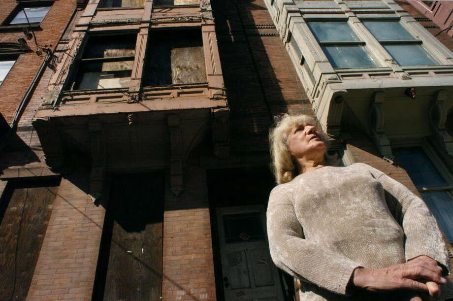 Nadia Ferran is shown in front of 54 Clinton Ave. in Albany in 2004. The building was demolished in 2011. (Michael P. Farrell/Times Union archive) Photo: MICHAEL P. Farrell / ALBANY TIMES UNION