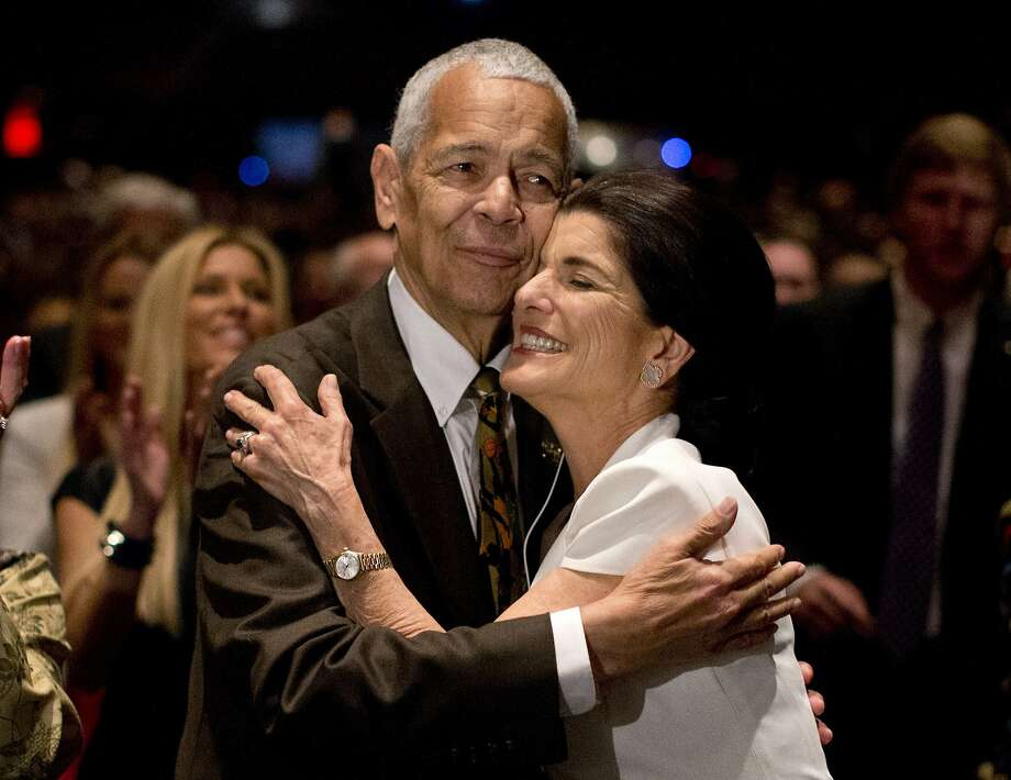 "Social activist Julian Bond hugs Luci Baines Johnson, the younger daughter of President Lyndon Baines Johnson nafter singing ""We Shall Overcome"" before President Barack Obama spoke at the LBJ Presidential Library, Thursday, April 10, 2014, in Austin, Texas, during the Civil Rights Summit to commemorate the 50th anniversary of the signing of the Civil Rights Act. (AP Photo/Carolyn Kaster) Photo: Carolyn Kaster, Associated Press"