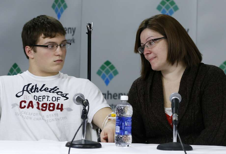 Amanda Leonard, right, looks to her son, Brett Hurt, 16, a sophomore at Franklin Regional High School, during a news conference at Forbes Regional Hospital, Thursday, April 10, 2014, in Monroeville, Pa. Hurt is one of the victims injured in the multiple stabbings at the high school in Murrysville, Pa., on Wednesday, April 9. Authorities have charged Alex Hribal, 16, with four counts of attempted homicide and 21 counts of aggravated assault in the attack. (AP Photo/Keith Srakocic) Photo: Keith Srakocic, Associated Press