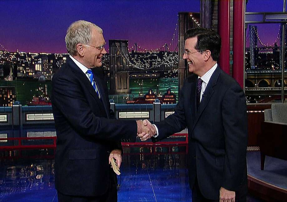 "David Letterman (left) greets Stephen Colbert on ""Late Show"" in 2011. Colbert will take over in 2015. Photo: ©2011 Worldwide Pants Inc., Associated Press"