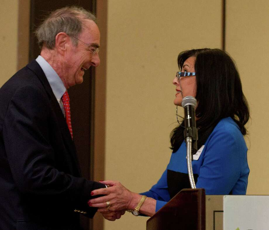 Brita Darany von Regensburg of Friends of Autistic People presents the R. Michael Dunne Quality of Life award to Peter Malkin of Malkin Holdings LLC during the Greenwich Chamber of Commerce annual awards luncheon at the Hyatt Regency in Greenwich, Conn., on Thursday, April 10, 2014. Photo: Lindsay Perry / Stamford Advocate