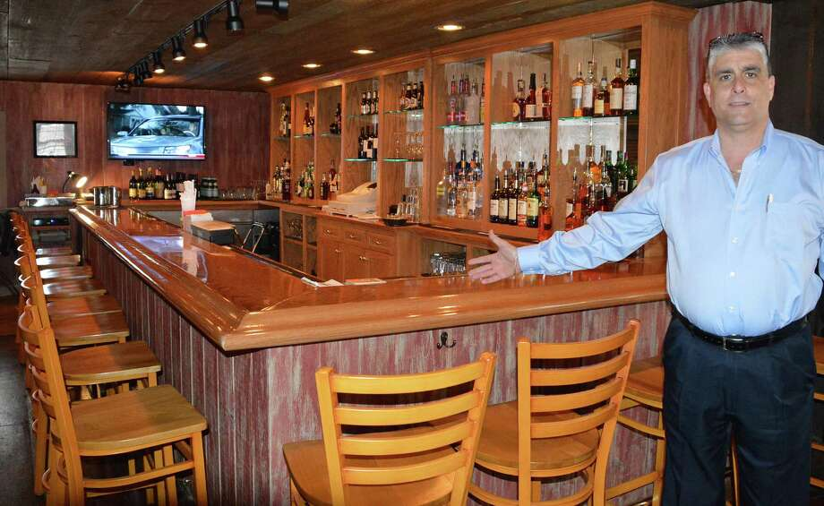 Richard Nistico, co-owner of the Red Barn, shows off the restaurant's new Tap Room patron bar. Photo: Jarret Liotta / Fairfield Citizen