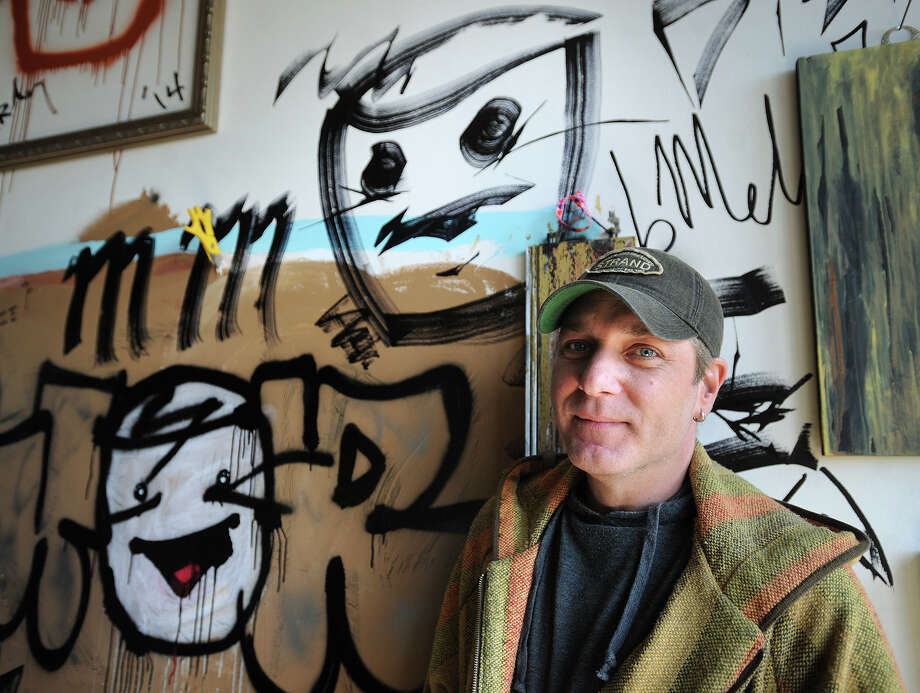 "Artist Brian Michael Riley, aka ""The Marshmallow Man"", in his apartment/artist's studio at Read's Artspace in downtown Bridgeport, Conn. on Thursday, April 10, 2014. Riley has been arrested twice for tagging city buildings with his marshmallow happy face signature. Photo: Brian A. Pounds / Connecticut Post"