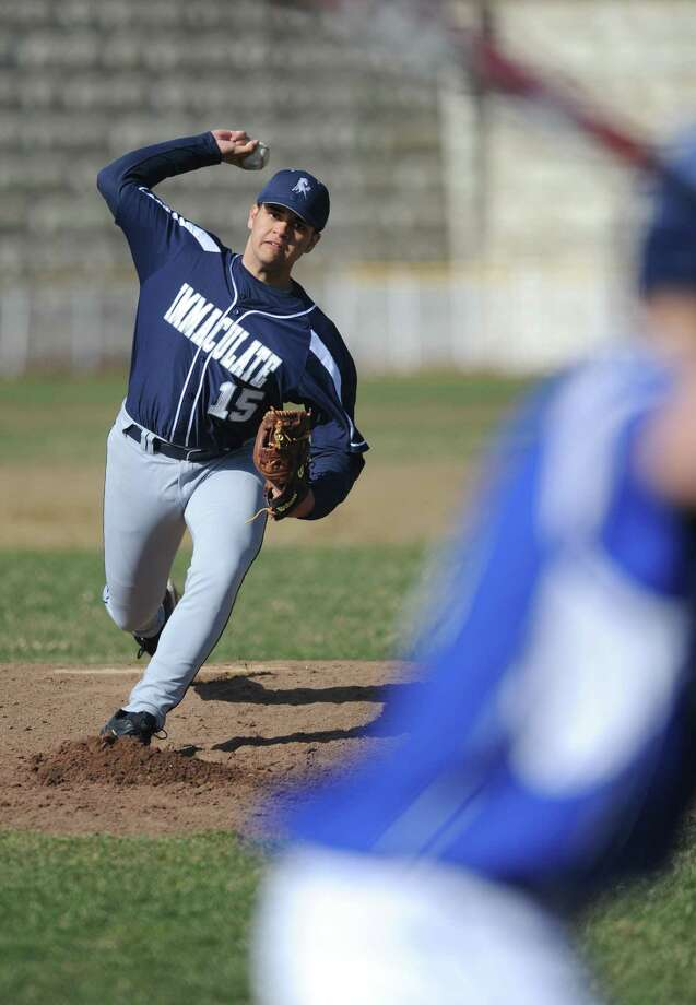 Immaculate's Carlos Espinal (15) throws a pitch in Immaculate's 11-2 win over Abbott Tech in the high school baseball game at Henry Abbott Technical School in Danbury, Conn. Wednesday, April 9, 2014. Photo: Tyler Sizemore / The News-Times
