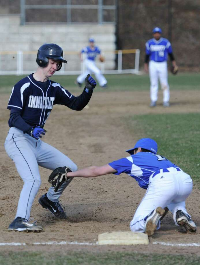 Photos from Immaculate's 11-2 win over Abbott Tech in the high school baseball game at Henry Abbott Technical School in Danbury, Conn. Wednesday, April 9, 2014. Photo: Tyler Sizemore / The News-Times
