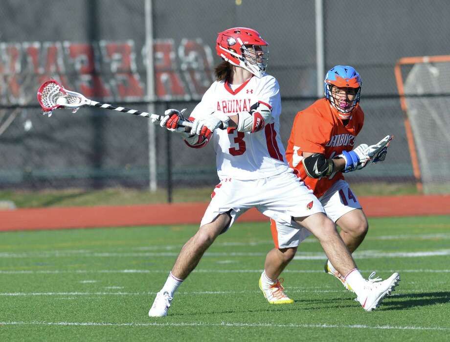 Kyle Foote (#3) of Greenwich scores the first goal of the game during the high school lacrosse match between Greenwich High School and Danbury High School at Greenwich, Wednesday, April 9, 2014. Greenwich won the match, 19-3. Photo: Bob Luckey / Greenwich Time