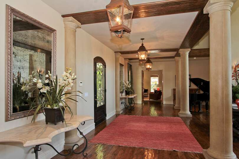 Coffered Ceiling Foyer : The foyer features a coffered ceiling and support pillars