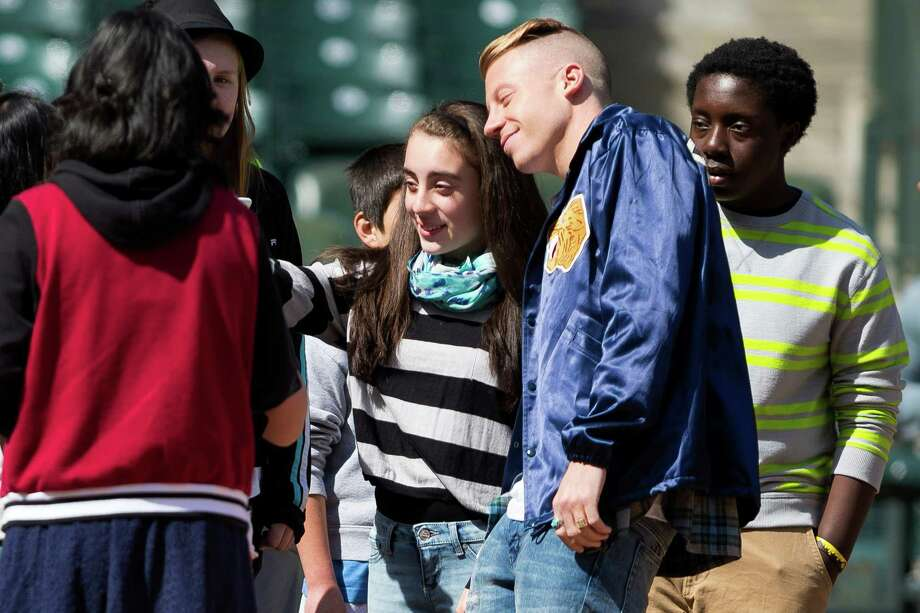 Students take pictures with Mariners pitcher Felix Hernandez and Grammy Award-winning artist Macklemore who showed up on set of an anti-bullying campaign Thursday at Safeco Field in Seattle. The Seattle Mariners are participating in an anti-bullying campaign targeted at middle school students in Washington, with a component of the campaign being public service announcements for radio and TV. Photo: JORDAN STEAD, SEATTLEPI.COM / SEATTLEPI.COM