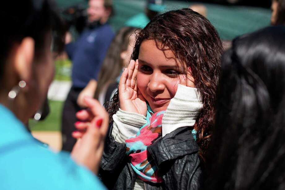 Maria Roman, 13, tries to keep it together after Mariners pitcher Felix Hernandez and Grammy Award-winning artist Macklemore showed up on the set of an anti-bullying campaign Thursday at Safeco Field in Seattle. The Seattle Mariners are participating in an anti-bullying campaign targeted at middle school students in Washington, with a component of the campaign being public service announcements for radio and TV. Photo: JORDAN STEAD, SEATTLEPI.COM / SEATTLEPI.COM