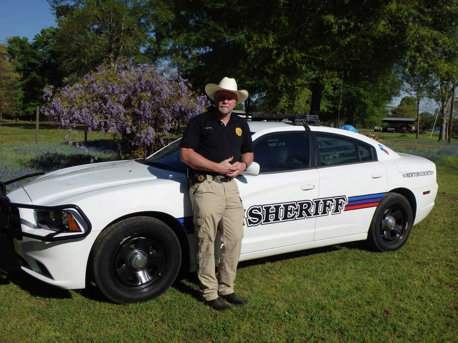 Newton County Sheriff, Ed Shannon , showing off one of his new vehicles. photo by submission