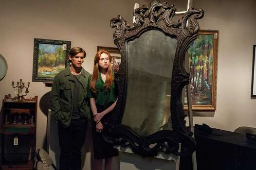 'Oculus' - Now young adults, sibs Tim and Kaylie are still trying to recover from -- and get to the bottom of -- their parents' deaths more than a decade ago. Tim is skeptical, but Kaylie believes an antique mirror is to blame, and sets out to prove it. Available Dec. 3 Photo: John Estes /  © 2013 Lasser Productions, LLC. All Rights Reserved.