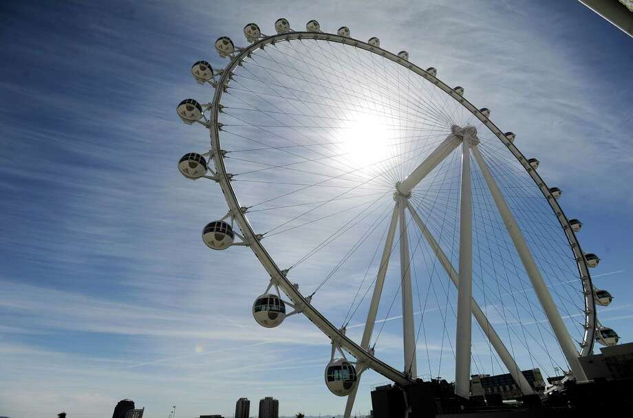 The Las Vegas High Roller at The LINQ begins to operate on Monday, March 31, 2014, in Las Vegas. The 550-foot-tall attraction, which opened to the public on Monday, is the highest observation wheel in the world and features 28 cabins that can accommodate up to 40 people each. (AP Photo/David Becker)  ORG XMIT: MER2014040111334652 Photo: DAVID BECKER / FR170737 AP