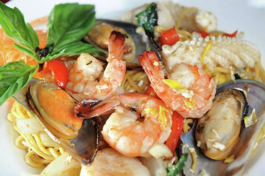 Siam Noodle is stir-fried shrimp, scallops, squid and mussels with egg noodles, onions, carrots, red peppers, fresh basil and egg on Thursday, April 3, 2014, in Rensselaer, N.Y. (Cindy Schultz / Times Union) Photo: Cindy Schultz / 00026352A