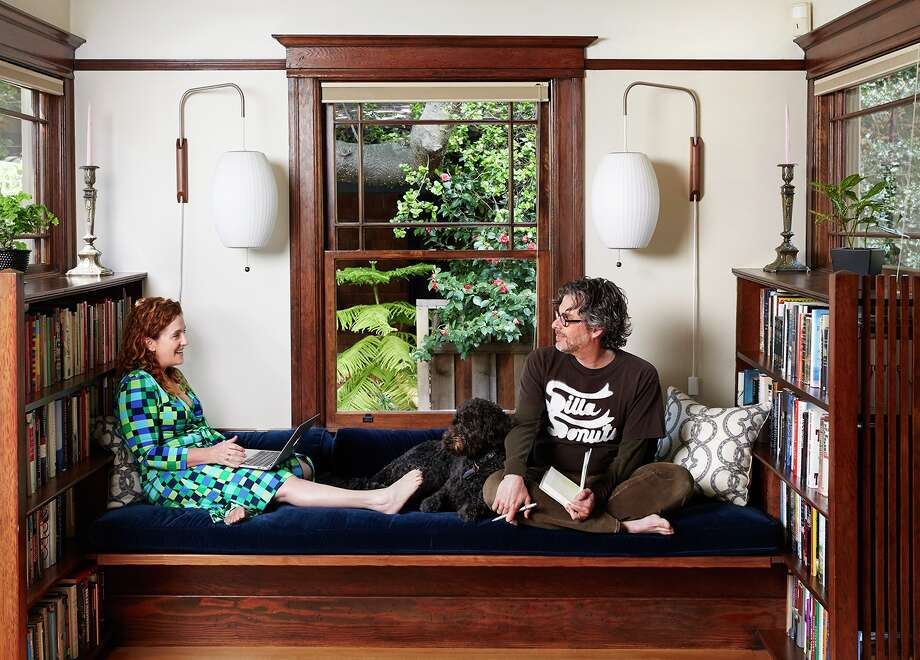 Authors Ayelet Waldman and Michael Chabon lounge on the window seat in their Berkeley craftsman. Photo: Aya Brackett / Remodelista