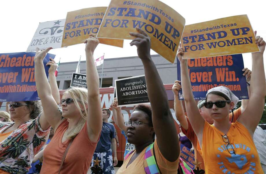 Supporters and opponents of an abortion limitations bill demonstrate outside the Texas Capitol last summer before the bill's passage. The Fifth Circuit upheld the bill based on an irrational definition of rational. Photo: Associated Press File Photo / AP