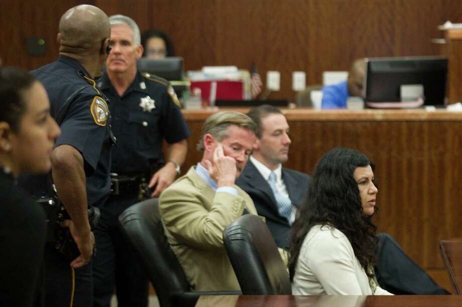 Ana Lilia Trujillo sits at the defense table after being found guilty of killing her boyfriend, after the jury deliberated less than two hours, on Tuesday, April 8, 2014, in Houston. Trujillo, 45, was found guilty murder, in the killing her 59-year-old boyfriend, Alf Stefan Andersson with the heel of a stiletto shoe, at his Museum District high-rise condominium in June 2013. Photo: Brett Coomer, Houston Chronicle / © 2014 Houston Chronicle