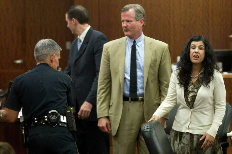 """Ana Lilia Trujillo, right, mouths, """"I love you'"""" as she is taken into custody after being found guilty of killing her boyfriend, after the jury deliberated less than two hours, on Tuesday, April 8, 2014, in Houston. Trujillo, 45, was found guilty murder, in the killing her 59-year-old boyfriend, Alf Stefan Andersson with the heel of a stiletto shoe, at his Museum District high-rise condominium in June 2013. Photo: Brett Coomer, Houston Chronicle / © 2014 Houston Chronicle"""