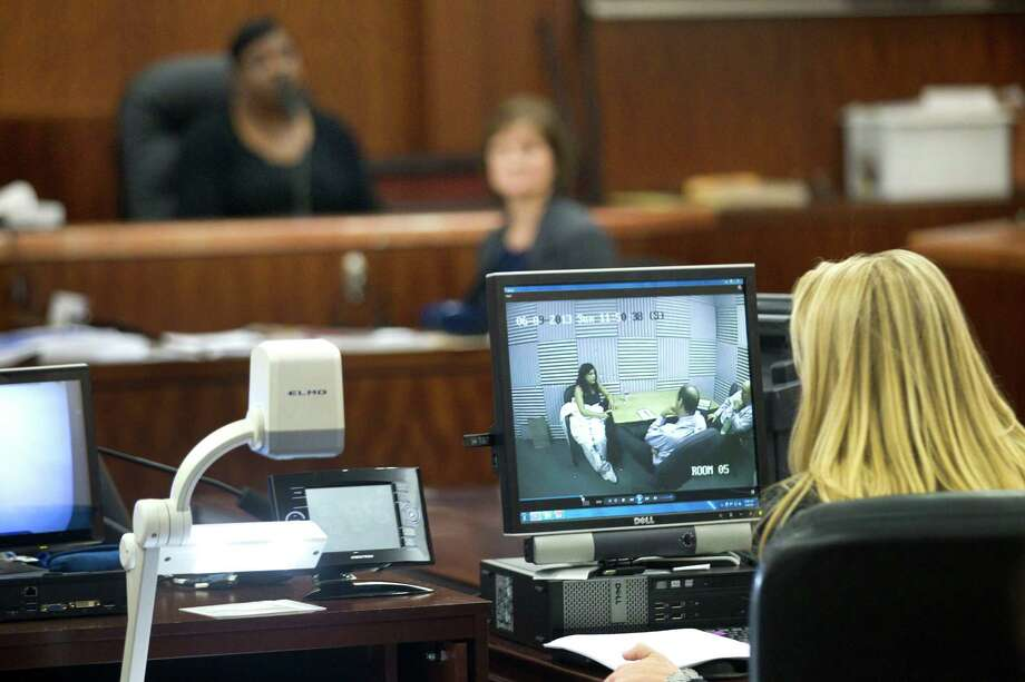 Interrogation video is shown during the trial against Ana Lilia Trujillo Tuesday, April 8, 2014, in Houston. Trujillo, 45, is charged with murder, accused of killing her 59-year-old boyfriend, Alf Stefan Andersson with the heel of a stiletto shoe, at his Museum District high-rise condominium in June 2013. Photo: Brett Coomer, Houston Chronicle / © 2014 Houston Chronicle