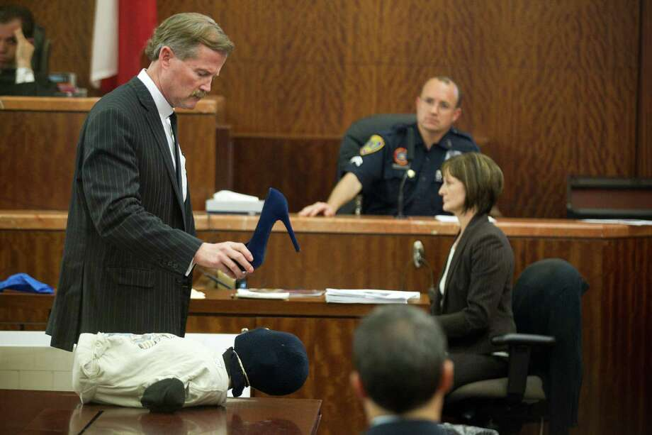 Defense attorney Jack Carroll questions Houston Police senior officer Christopher Duncan, crime scene investigator, on Tuesday, April 1, 2014, in Houston. Photo: Brett Coomer, Houston Chronicle / © 2014 Houston Chronicle