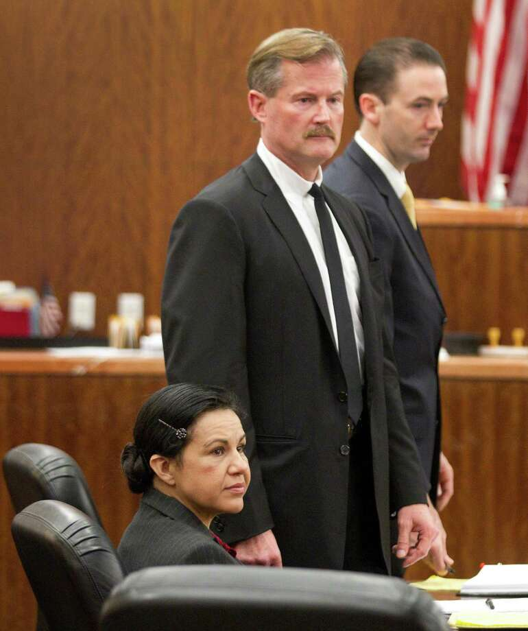 Ana Lilia Trujillo, left, sits in the courtroom before opening arguments in her trial Monday, March 31, 2014. Photo: Brett Coomer, Houston Chronicle / © 2014 Houston Chronicle