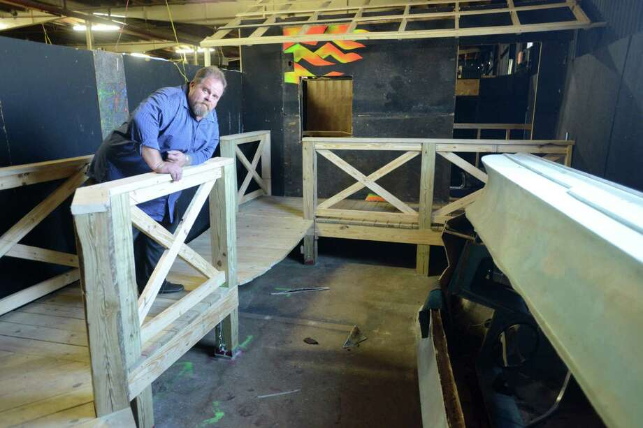 Gordon Wise stands over what is the swamp portion of a haunted house in an industrial property on East Commerce Street.  The former co-owner of Nightmare on Grayson haunted house has moved his operation east, to a former meat packing warehouse. Thursday, April 10, 2014. Photo: Billy Calzada, San Antonio Express-News / San Antonio Express-News