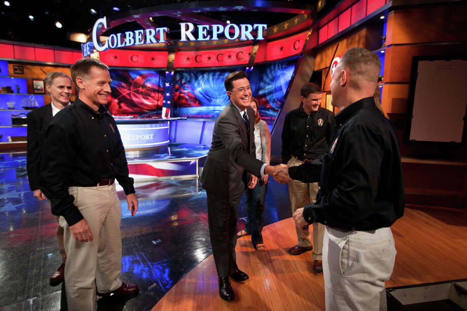 Stephen Colbert thanks Doug Hurley as Chris Ferguson and Rex Walheim look on after the crew of STS-135 appeared on The Colbert Report as part of their post flight tour in 2011.  Photo: Smiley N. Pool, Houston Chronicle / © 2011  Houston Chronicle