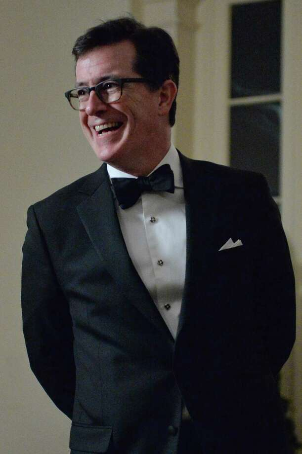 Comedian Stephen Colbert arrives at the White House in Washington on February 11, 2014 for the state dinner in honor of French President Francois Hollande.  Photo: NICHOLAS KAMM, AFP/Getty Images / 2014 AFP