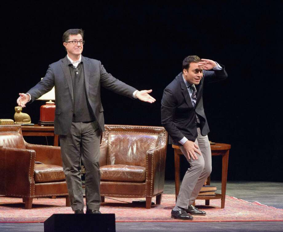 Stephen Colbert(L) and Jimmy Fallon(R) arrive on stage at the Montclair Film Festival Presents: Jimmy Fallon and Stephn Colbert in converstation at New Jersey Performing Arts Center on November 24, 2013. Photo: Dave Kotinsky, Getty Images / 2013 Getty Images