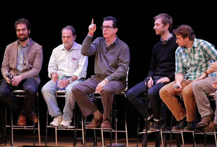"Stephen Colbert speaks on stage with a panal of writers from the ""Stephen Colbert Show"" during the panal ""A Lively Discussion With Stephen Colbert And His Writers"" during the 2013 New York Comedy Film Festival. Photo: Jemal Countess, Getty Images / 2013 Getty Images"
