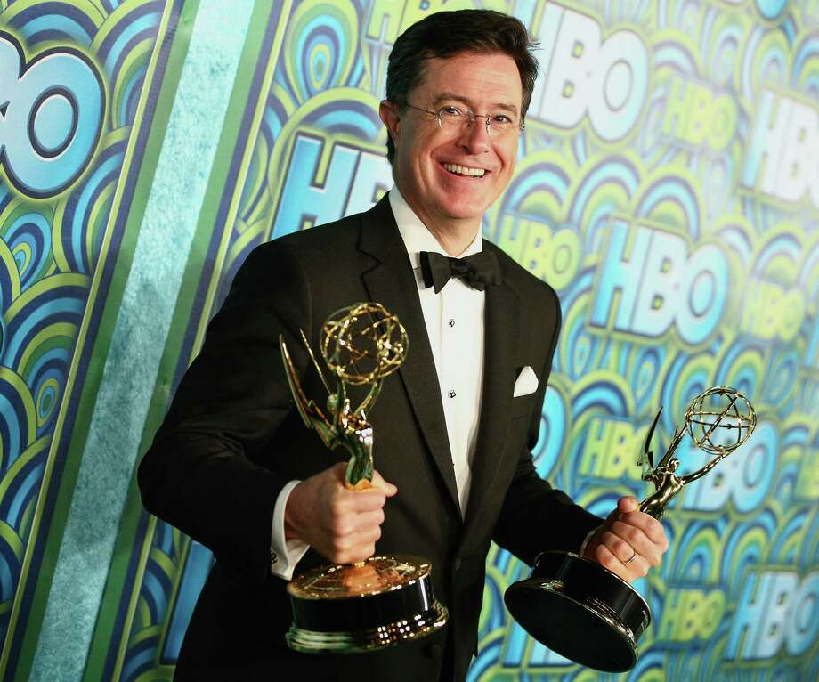 Stephen Colbert, winner of the Best Writing for a Variety Series Award and the Variety Series Award for 'The Colbert Report' attends an Emmy Awards post-party in 2013.  Photo: Imeh Akpanudosen, Getty Images / 2013 Imeh Akpanudosen