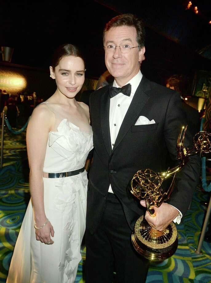 Actors Emilia Clarke (L) and Stephen Colbert attend HBO's official Emmy after party in 2013.  Photo: Jeff Kravitz, FilmMagic / 2013 Jeff Kravitz