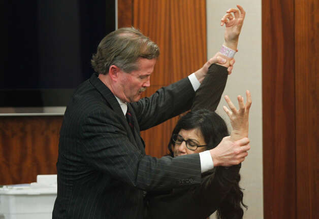 Defense attorney Jack Carroll, left reenacts the night of the crime with convicted killer Ana Trujillo during the punishment phase of her trial Thursday, April 10, 2014, in Houston. Trujillo was convicted in the brutal 2013 slaying of her boyfriend, Alf Stefan Andersson, using a 5-inch stiletto shoe. ( Brett Coomer / Houston Chronicle ) Photo: Brett Coomer/Houston Chronicle
