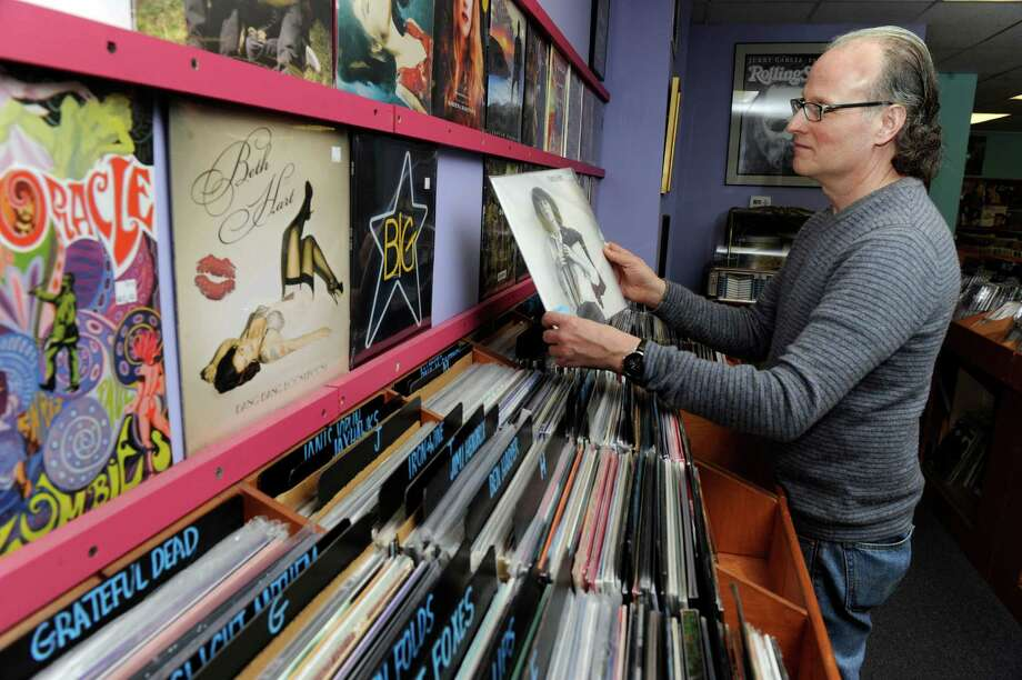 Brian Gerosa, 53, owner of Gerosa Records in Brookfield, Conn., looks through the stores collection of records Thursday. Photo: Carol Kaliff / The News-Times