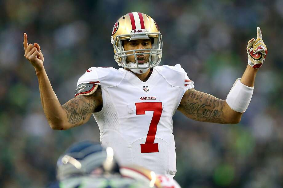 Colin Kaepernick is one of three football players whose names are in a police report. None has been charged with a crime. Photo: Ronald Martinez, Getty Images