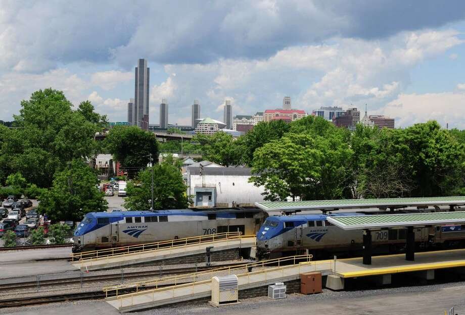 A Penn Station bound train, left, departs from Albany-Rensselaer Train Station Monday June 17, 2013, in Rensselaer, N.Y. Sen. Charles Schumer and State Sen. Little are asking Amtrak to add special baggage cars which could accommodate bicycle transportation. Bikes are currently not allowed on the Adirondack or Ethan Allen Lines. Schumer  hopes this would increase tourism possibilities. (Will Waldron/Times Union) Photo: Will Waldron / 10022827A