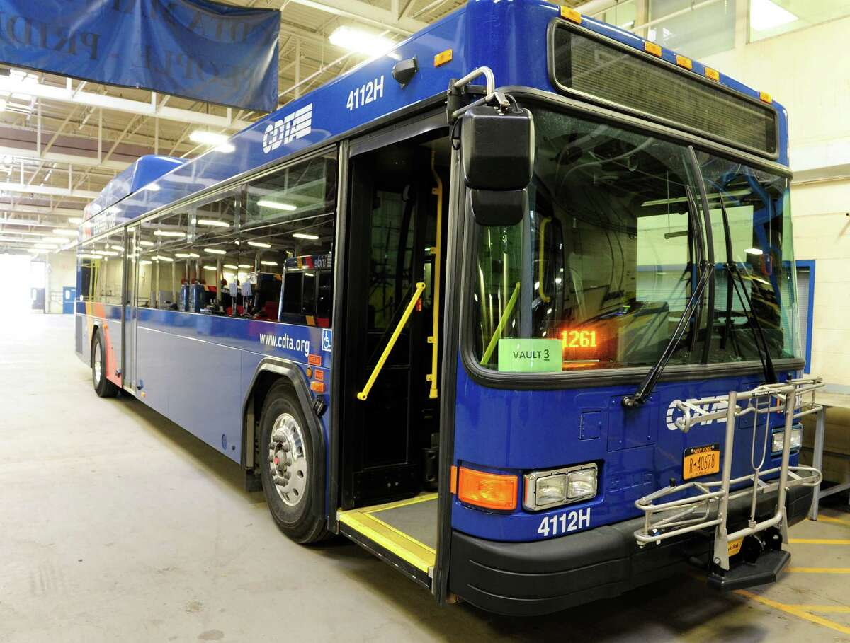 A view of a CDTA bus at the company's garage seen here on on Thursday, April 10, 2014, in Albany, N.Y. New Genfare FastFare fare boxes are being installed on the company's buses. The new fare boxes are being installed in buses with a new design that splits the slot for dollar bills and coins. The new fare box is also smart card ready, a function that CDTA plans to begin using within the next year. (Paul Buckowski / Times Union)