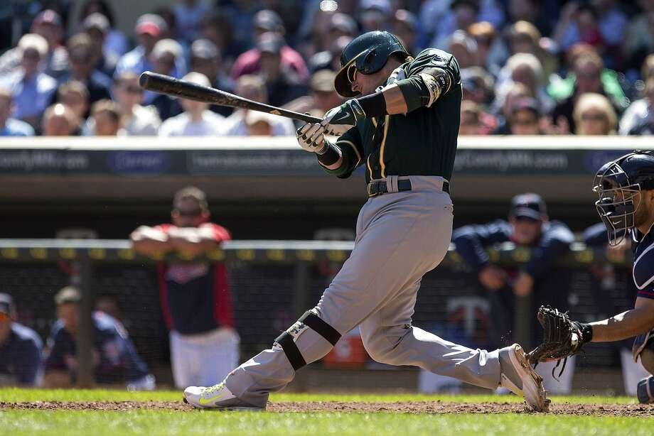 A's third baseman Josh Donaldson had a two-run homer in the third inning and an RBI single, above, in the sixth. Photo: Jesse Johnson, Reuters