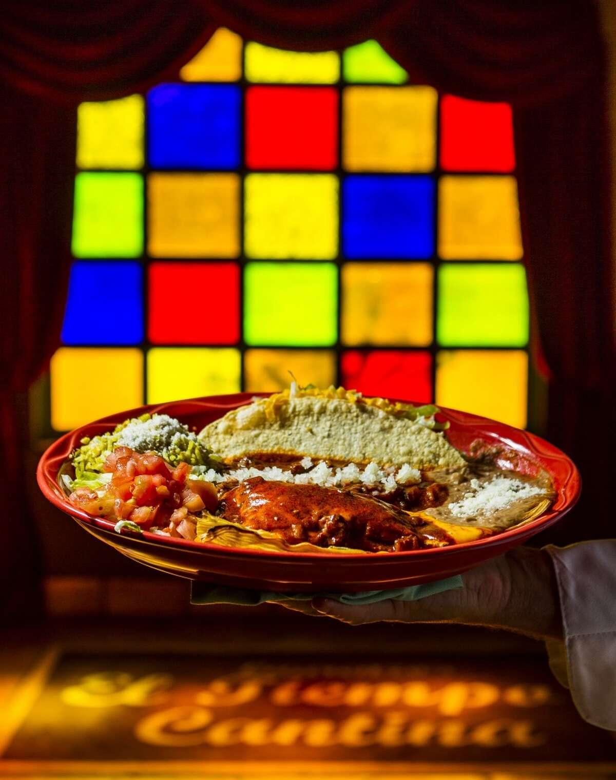 El Tiempo Cantina's flauta, tamale and taco plate.