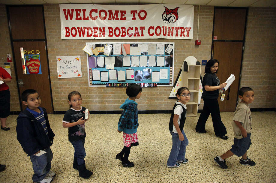 Bowden Elementary students on the move. They're among a key demographic that one day will drive the Texas workforce. Photo: Express-News File Photo / San Antonio Express-News