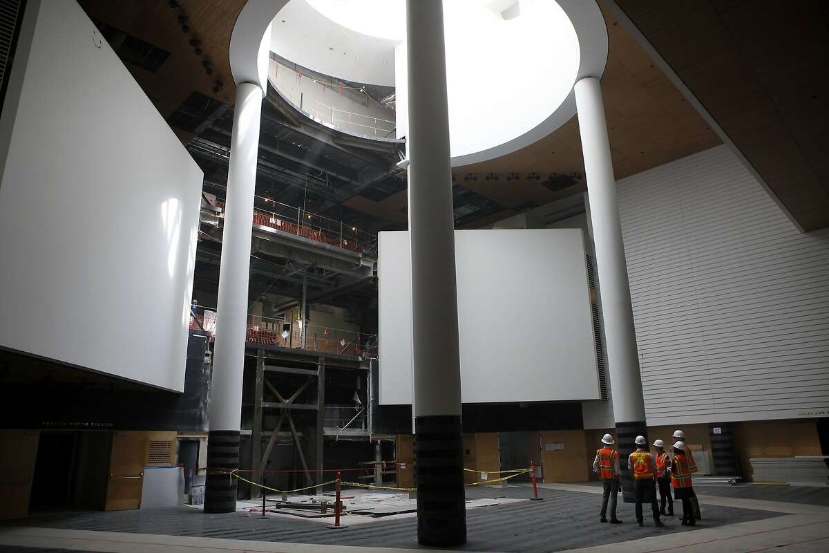 A tour group lead by Architect Craig Dykers stands in the atrium of the San Francisco Museum of Modern Art which is missing it's main staircase as expansion construction continues, in San Francisco, CA, Tuesday April 8, 2014.