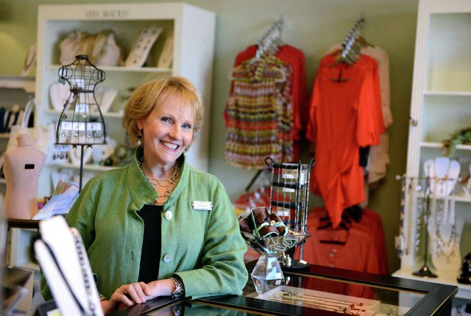 Lorraine McGowan stands in her revamped shop Lorraine K., formerly Country Heart, Thursday, April 10, 2014, in Monroe, Conn. Photo: Autumn Driscoll / Connecticut Post