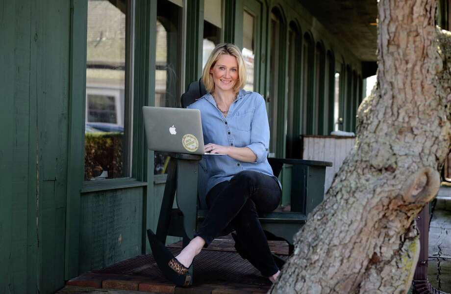 Maggie Lord, of Rustic Wedding Chic, sits at her laptop Thursday, April 10, 2014, in Fairfield, Conn. After planning her own wedding in 2009, Lord turned her research into an informative blog and now a 6 figure company. Photo: Autumn Driscoll / Connecticut Post