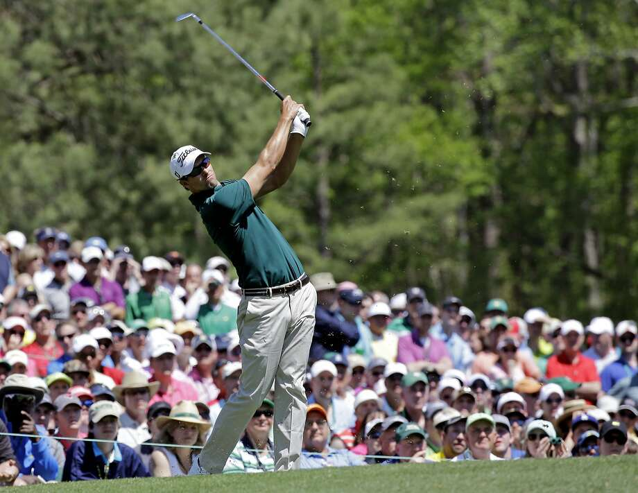 Defending champ Adam Scott tees off on the 12th hole during the Masters' first round. Photo: David J. Phillip, Associated Press