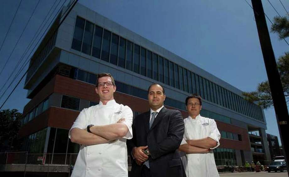 Museum Park Cafe Chef Justin Basye left, Balcor Hospitality owner and managing director Chris Balat center and Pastry Chef Chris Leung right, during in front of the new restaurant in the Parc Binz building Thursday, April 10, 2014, in Houston. Photo: James Nielsen, Houston Chronicle / © 2014  Houston Chronicle