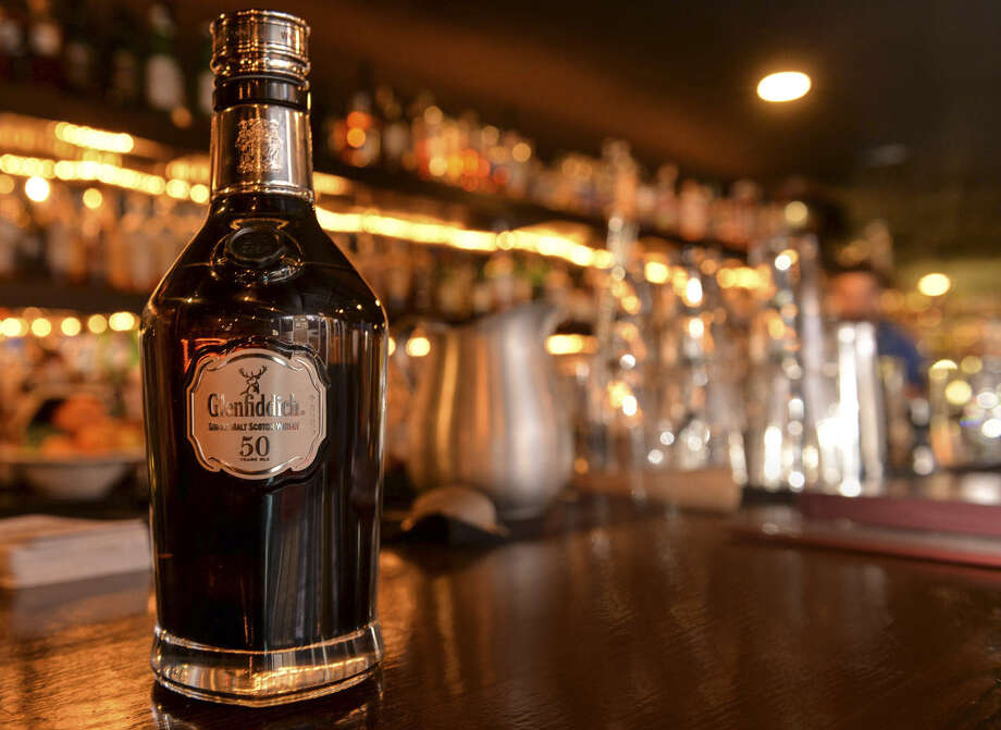 Is your tax refund bringing you an unexpected windfall? Consider spending it on some 50-year-old Scotch whisky. Photo: Express-News File Photos / San Antonio Express-News