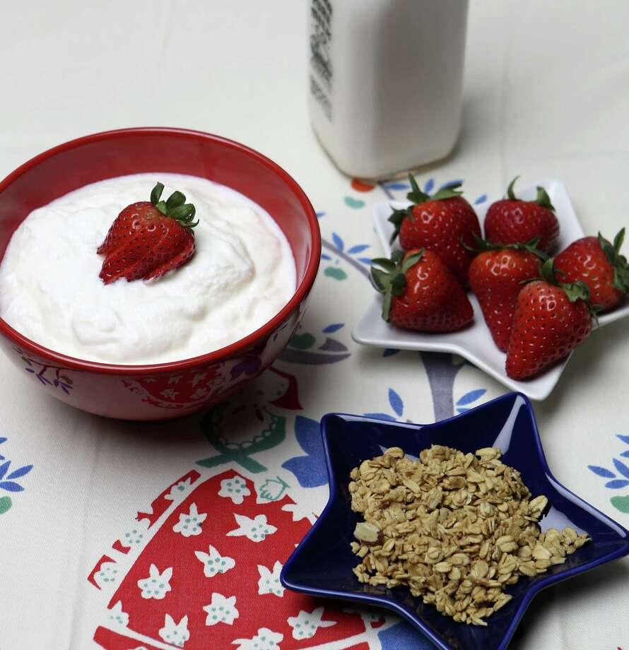 Homemade yogurt, served with granola and fresh berries, makes a tasty, healthful breakfast. Photo: Helen L. Montoya / San Antonio Express-News / ©2013 San Antonio Express-News