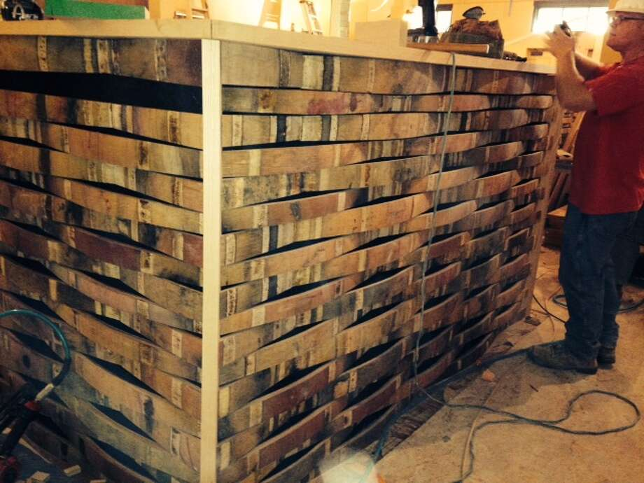 Several half walls in the downstairs restaurant are made out of old barrel staves